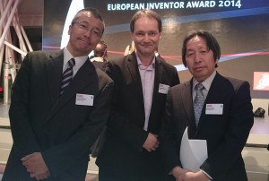 Laurent Tonnelier (mobiLead) between Takayuki Nagaya (DENSO Wave) and Masahiro Hara (DENSO Wave) at European Inventor Award in Berlin, Germany.